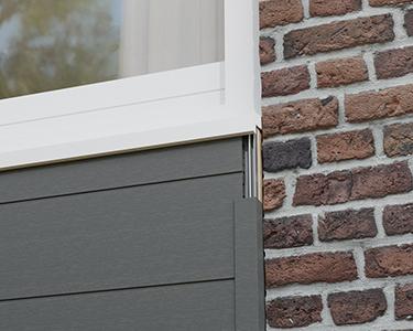Verbindung zwischen Fassadenverkleidung und Fensterrahmen